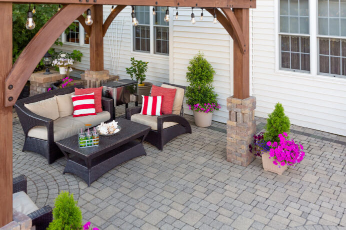 Comfortable chairs on an outdoor brick patio Deck Stunning Covered Deck Ideas