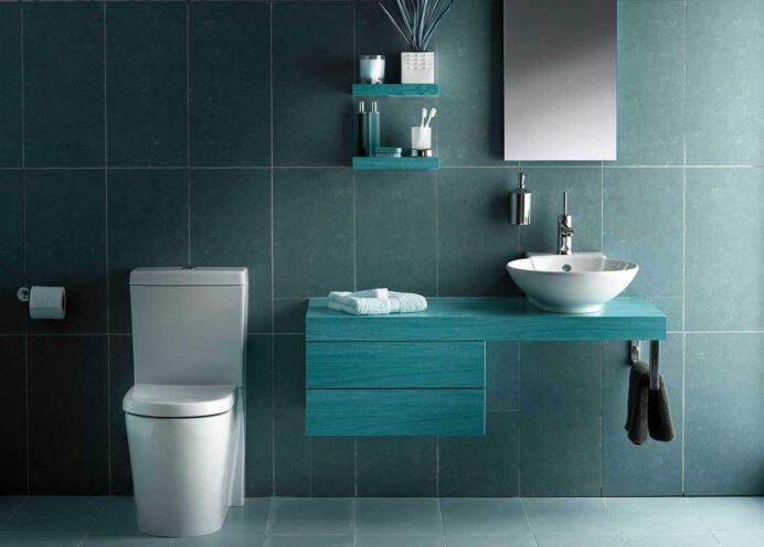 Cold-tone-modern-bathroom-with-toilet-sink-on-wooden-countertop-and-mirror Bathroom Cool Blue Bathroom Ideas