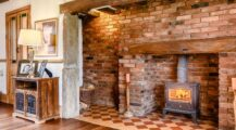 grand_english_traditional_brick_fireplace_with_wood_burning_stove_and_tile_base Fireplace cosy Brick Fireplace Ideas