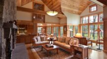 Rustic-living-room-in-wood-and-stone-with-lovely-views-outside Ceiling Cozy Wood Ceiling Ideas