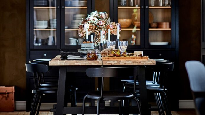 a-dining-area-with-a-wood-top-table-with-black-legs-and-blac Dining Room Dining Room Hutch Decor