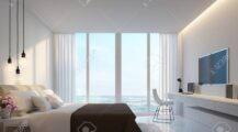 modern-white-bedroom-with-sea-view-3d-rendering-image-decorate-wall-with-hidden-warm-light-white-fur Window Stylish Window Valance Ideas